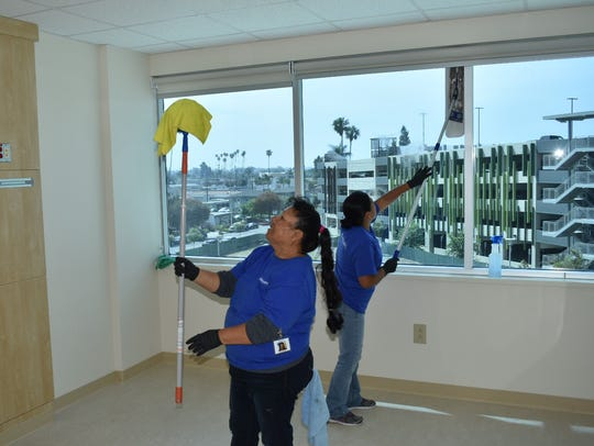 Workers clean one of the 250 patient rooms in the new Community Memorial Hospital tower in Ventura earlier this summer.