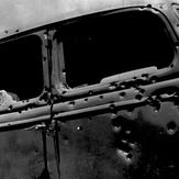 The bullet-riddled car in which Bonnie Parker and Clyde Barrow were ambushed near Gibsland in May 1934.