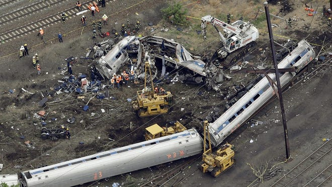 FILE - In this May 13, 2015, file photo, emergency personnel work at the scene of a derailment in Philadelphia of an Amtrak train headed to New York. A preliminary hearing is scheduled Tuesday, Sept. 12, 2017, for Brandon Bostian charged in a Philadelphia derailment that killed eight in 2015. (AP Photo/Patrick Semansky, File)