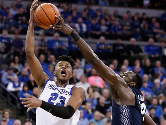 FILE - In this Sunday, Feb. 19, 2017 file photo, Creighton's Justin Patton (23) is blocked by Georgetown's Akoy Agau, right, during the second half of an NCAA college basketball game in Omaha, Neb. The role of the big man has changed in the NBA, and that's evident in the way teams pick centers and post players entering the draft on Thursday, June 22, 2017. Patton, a redshirt freshman, was the Big East freshman of the year and is a possible first-round pick in Thursday's NBA draft. (AP Photo/Nati Harnik, File)