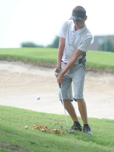 A golfer swings on the ninth hole at the Chuck Morton Junior Golf Tournament on Thursday at Big Creek.