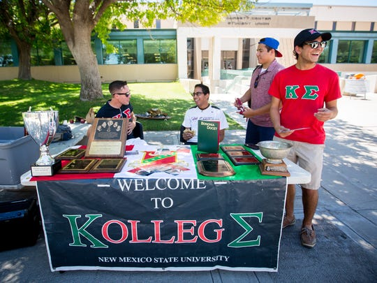 Members of the Kappa Sigma fraternity man a recruiting
