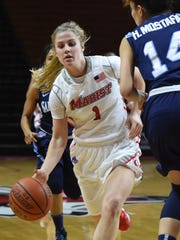 Marist College's Claire Oberdorf attacks the Saint