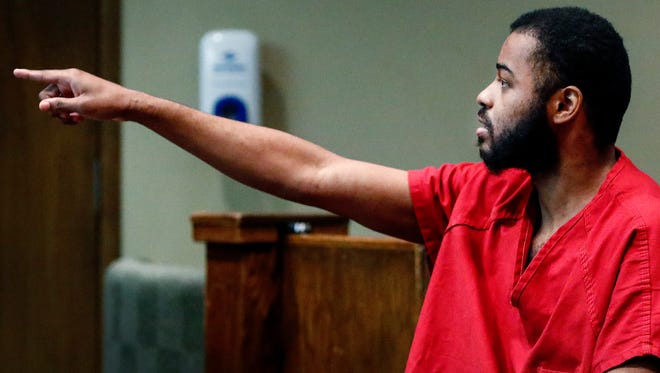 Justin Welch, points at the Judge Mark Ward during a appearance in court for a hearing involving his mental competency to stand trial and whether he should be medicated against his will. Welch, is charged with fatally hitting Memphis police Officer Verdell Smith with a stolen car and shooting three other people downtown last year.