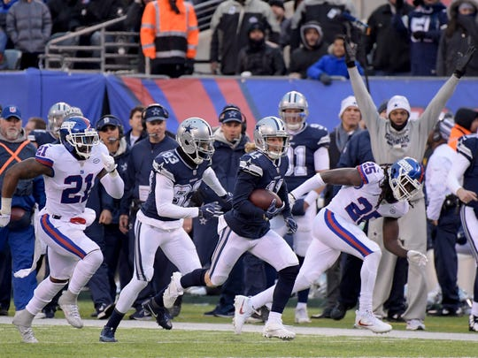 Dallas Cowboys wide receiver Cole Beasley (11) runs the ball deep for a first down against the New York Giants during the fourth quarter of an NFL football game, Sunday, Dec. 10, 2017, in East Rutherford, N.J.