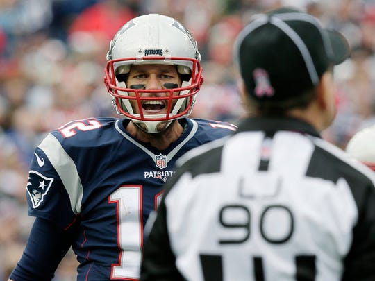 New England Patriots quarterback Tom Brady argues his point with line judge Mike Spanier (90) during the first half of an NFL football game against the New York Jets, Sunday, Oct. 25, 2015, in Foxborough, Mass. (AP Photo/Charles Krupa)