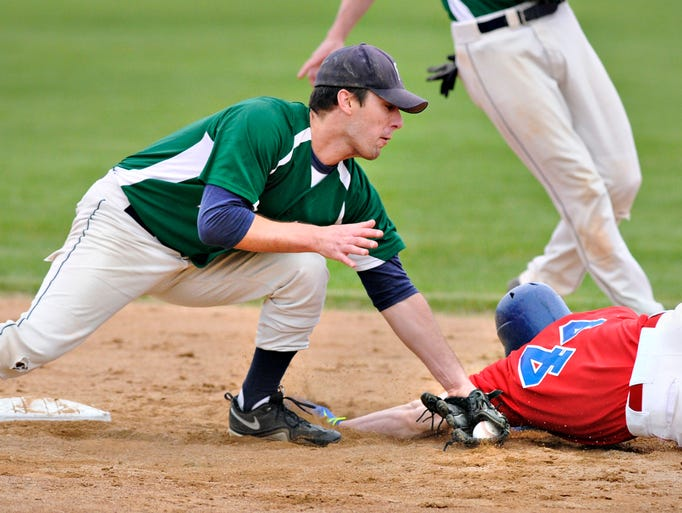 Sartell's Dan O'Connell tag out St. Joseph's Ethan Carlson as he tries to steal second in the first inning in St. Joseph.