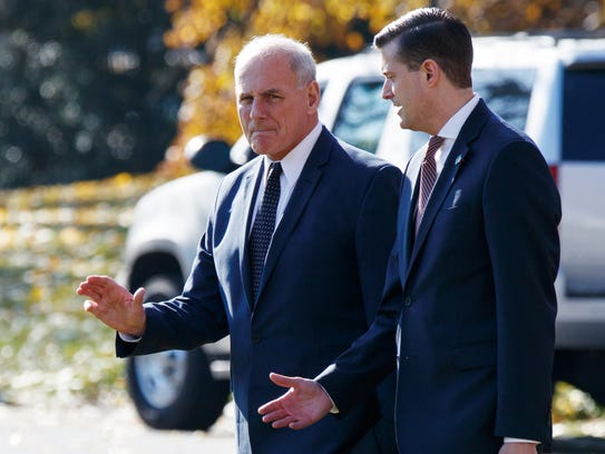 In this Nov. 29, 2017 file photo, White House Chief of Staff John Kelly, left, walks with White House staff secretary Rob Porter to board Marine One on the South Lawn of the White House.