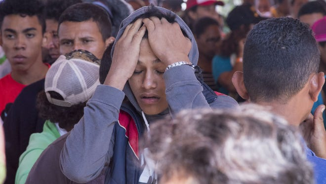 Central American migrants gathered outside a church in Puebla, Mexico, on April 7, 2018, for a caravan that hoped to travel to the U.S. border, drawing the ire of President Trump.