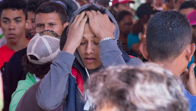 Central American migrants gathered outside a church in Puebla, Mexico for a caravan hoped to travel to the US border drawing the ire of President Trump.