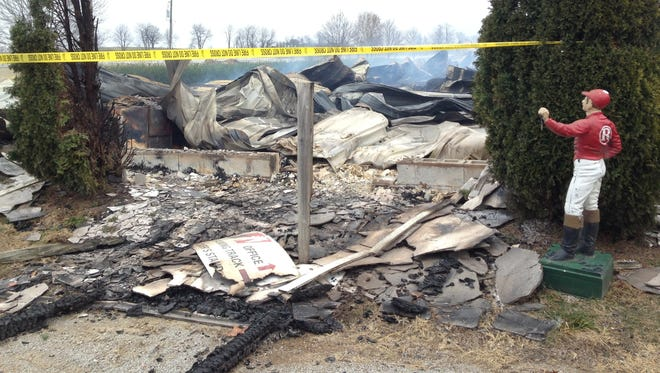 Debris lies on the ground after a fire at the Mercury Equine Center in Lexington, Ky. on Dec. 18, 2016. Center owner Eric Reed said dozens of horses were inside the barn and several were saved before the building started to collapse.