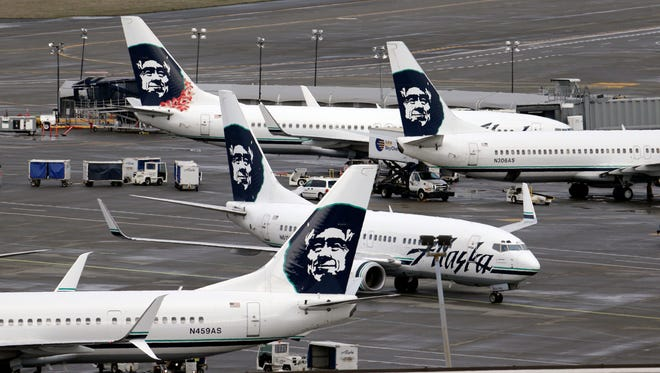 This file photo from March 24, 2015, shows Alaska Airlines planes at Seattle-Tacoma International Airport.