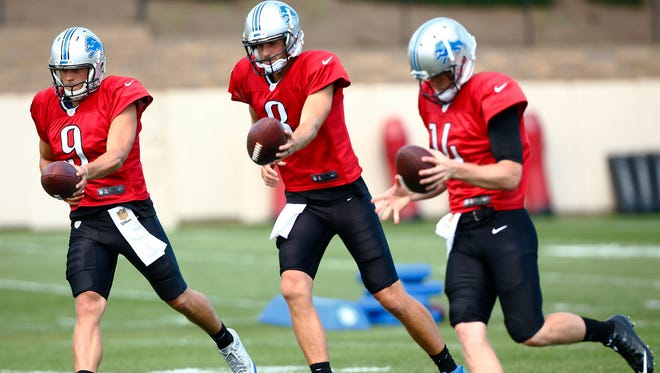Lions quarterbacks Matthew Stafford (9), Dan Orlovsky (8) and Jake Rudock (14) run through drills during an NFL football scrimmage with the Steelers at the Steelers' training camp in Latrobe, Pa., on Tuesday.