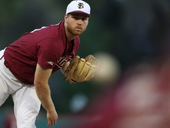 FSU's Andrew Karp pitches against UCF during the Seminoles'