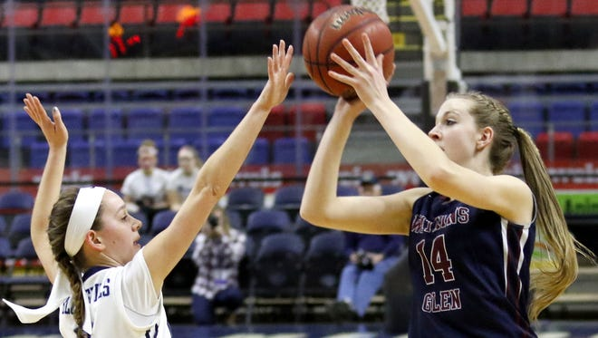 Amanda Pike of Watkins Glen puts up a shot over the outstretched arm of Moravia's Hannah Morse during the Section 4 Class C girls basketball championship at the Floyd L. Maines Veterans Memorial Arena in Binghamton on Feb. 27.