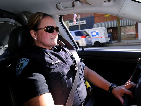 Eaton Rapids Police Officer Lisa Kirby in a patrol car in 2014. Kirby in January 2019 reached a six-figure settlement with the department over sexual harassment claims.