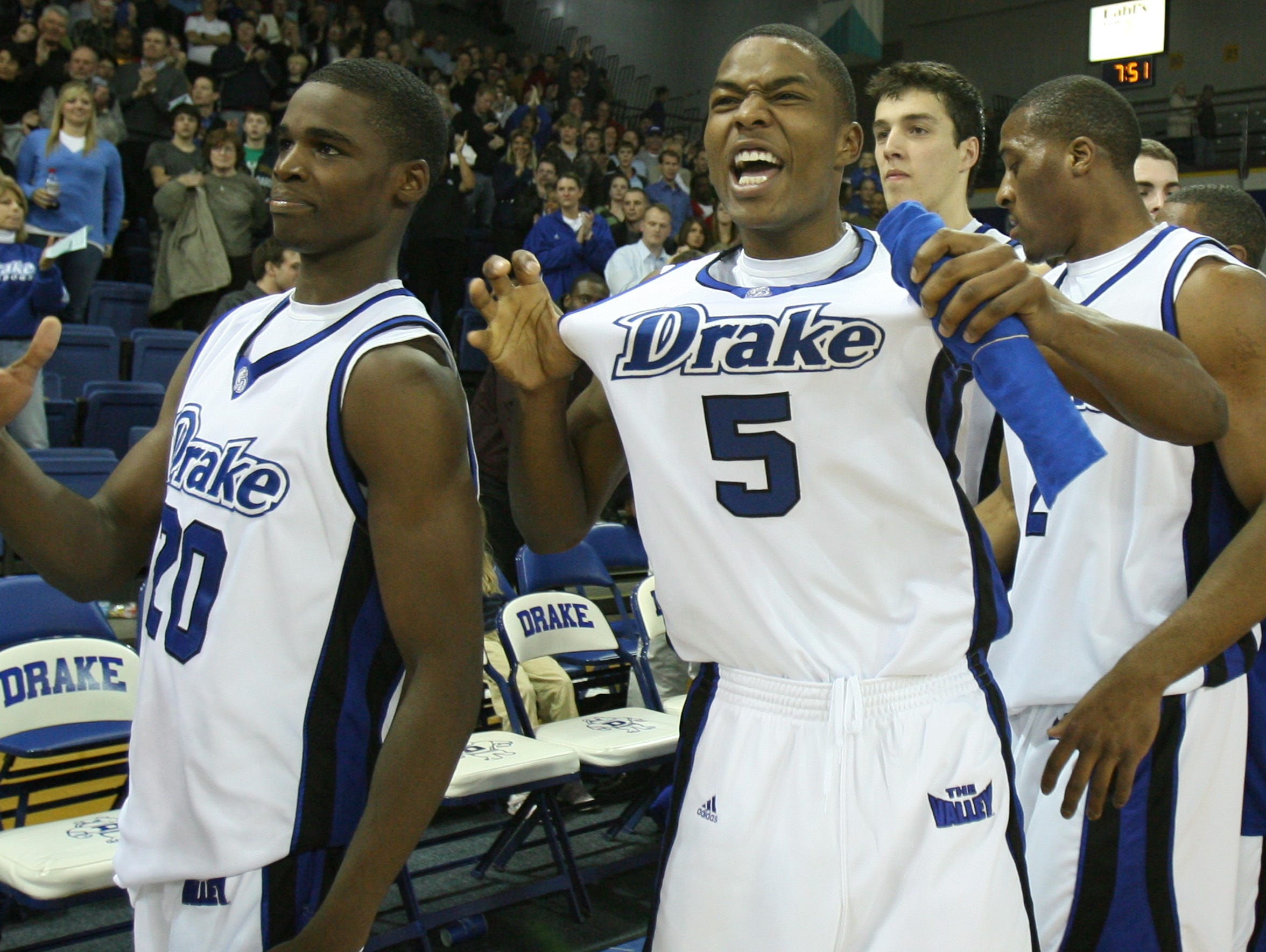 Drake's Josh Young, left, and Leonard Houston (5) celebrate