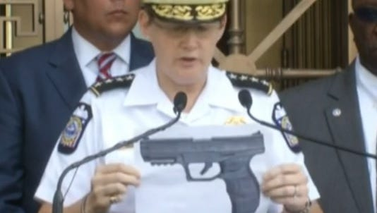 This frame grab from NBC News shows Columbus police chief Kim Jacobs holding up a photo of a replica of a BB-gun that 13-year-old Tyree King reportedly pulled from his waistband before he was shot by a police officer Wednesday night in east Columbus.