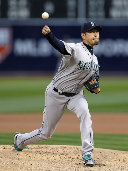 Seattle Mariners pitcher Hisashi Iwakuma works against the Oakland Athletics in the first inning of a baseball game Tuesday, May 3, 2016, in Oakland, Calif. (AP Photo/Ben Margot)