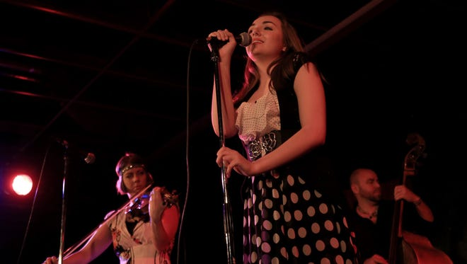 Heather Wilhelm, Liv Rylan and Mason Cottam lead the band Wilhelm through a set of gypsy-tinged jazz songs Thursday at Off The Cuff in Cedar City.