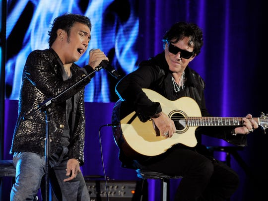 "Arnel Pineda, left, and Neal Schon of the rock band Journey perform onstage following a panel discussion on the Independent Lens documentary ""Don't Stop Believin': Everyman's Journey,"" at the PBS Summer 2013 TCA press tour at the Beverly Hilton Hotel on Tuesday, August 6, 2013 in Beverly Hills, Calif."