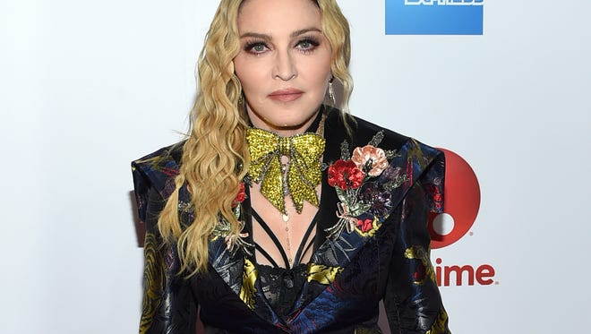 """FILE - This Dec. 9, 2016 file photo shows Madonna at the 11th annual Billboard Women in Music honors in New York. On Monday, the Hollywood Reporter announced that Universal had acquired the rights to """"Blond Ambition,"""" a script about the singer. On Tuesday, Madonna expressed her displeasure via an Instagram post. She said that only she was qualified to tell her story and """"anyone else who tries is a charlatan and a fool."""" (Photo by Evan Agostini/Invision/AP, File)"""