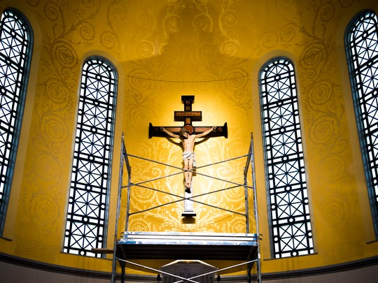A crucifix hangs behind the altar inside the new Cathedral