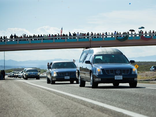 A hearse carrying the body of Hatch Police Officer Jose Chavez, who was killed Aug. 12, makes its way south on Interstate 25,  just past Hatch, N.M.