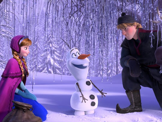 "This file image released by Disney shows, from left, Anna, voiced by Kristen Bell, Olaf, voiced by Josh Gad, and Kristoff, voiced by Jonathan Groff, in a scene from the animated feature ""Frozen."" ""Frozen"" has earned Disney more than $1.27 billion at the box office worldwide, becoming the most successful animated movie of all time."