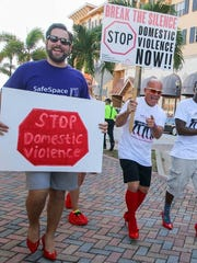 James Taylor (from left), Dan Pimpo and Ray Desmangles attend SafeSpace's Walk a Mile in Her Shoes event.