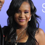 "FILE - In this Aug. 16, 2012, file photo, Bobbi Kristina Brown attends the Los Angeles premiere of ""Sparkle"" at Grauman's Chinese Theatre in Los Angeles. The daughter of the late singer and entertainer Whitney Houston, who was in hospice care after months of receiving medical care, died on Sunday, July 26, 2015. (Photo by Jordan Strauss/Invision/AP, File)"