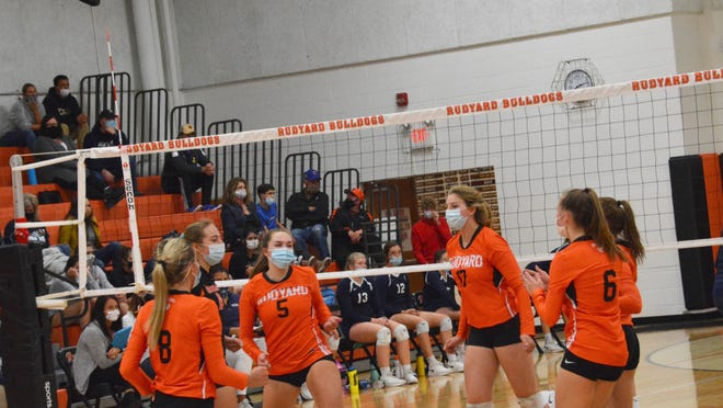 Rudyard volleyball players celebrate a point during a match this season. The Bulldogs beat Brimley 3-0 in an Eastern UP Conference match Tuesday night.