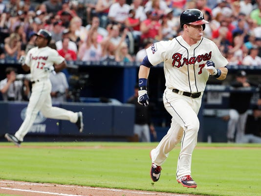 Atlanta Braves' Gordon Beckham, right, runs for first base on a force attempt to score teammate Mallex Smith, rear left, in the eighth inning of a baseball game against the Miami Marlins Sunday, May 29, 2016, in Atlanta. (AP Photo/David Goldman)