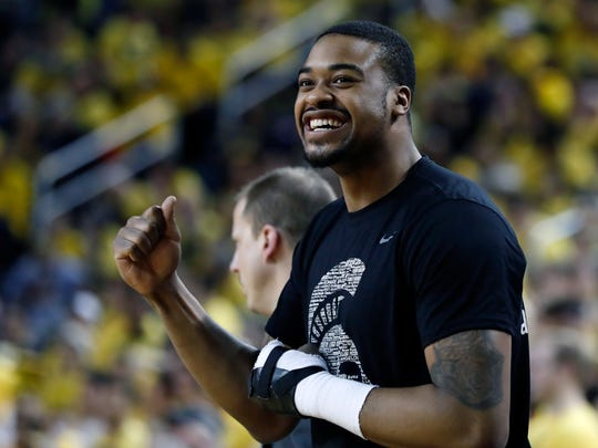 Michigan State forward Nick Ward pumps his fist as State defeats Michigan 74-64 during an NCAA college basketball game, Sunday, Feb. 24, 2019, in Ann Arbor, Mich. (AP Photo/Carlos Osorio)
