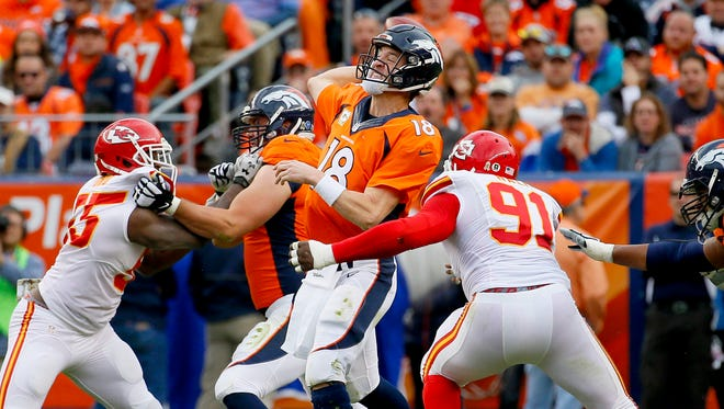 Denver Broncos quarterback Peyton Manning (18) throws during the first half of an NFL football game against the Kansas City Chiefs, Sunday, Nov. 15, 2015, in Denver.