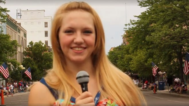 A still image of Megan Meriwether reporting for Radio One News Network, a student-run news program.