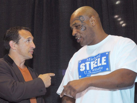 Ray Mancini has fun with Mike Tyson during a Tyson exhibition fight in Mancini's hometown of Youngstown, Ohio, in 2006. (photo by Mark Stahl, AP)