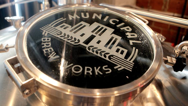 The Municipal Brew Works logo on the lid atop a brew kettle in the Hamilton microbrewery, which opened June 8.