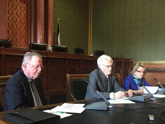 The three-person Revenue  Estimating Conference reviews state revenue figures Monday, Dec. 12, 2016, at the Iowa Capitol. From left are, David Underwood, a business consultant from Clear Lake; David Roederer, director of the Iowa Department of Management; and Holly Lyons, fiscal division director of the Legislative Services Agency.