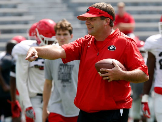 FILE - In this Saturday, Aug. 5, 2017, file photo, Georgia coach Kirby Smart coach directs his team during NCAA college football practice on Fan Day in Athens, Ga. (L. Jones/Athens Banner-Herald via AP, File)