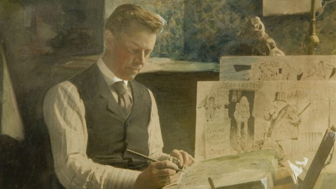In this vintage, hand-colored photo, political cartoonist and writer Eugene Zimmerman is shown working.