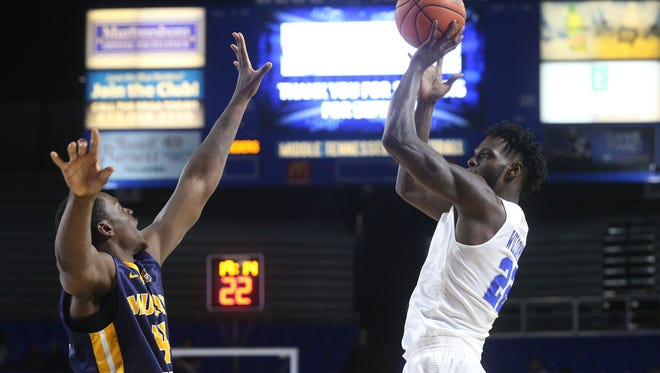 MTSU's JaCorey Williams (22) leads the Blue Raiders in points and rebounds per game.