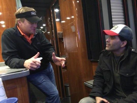 Jon Gruden talks with Scott Venci on the Monday Night Football bus.