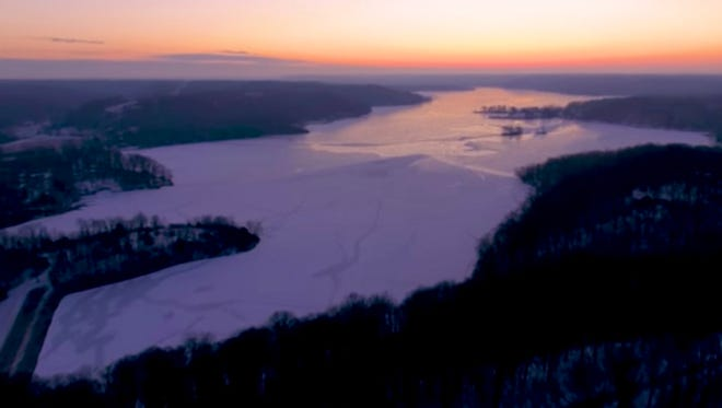 Lake Lemon sits frozen as the sun rises on the morning of January 3, 2018.
