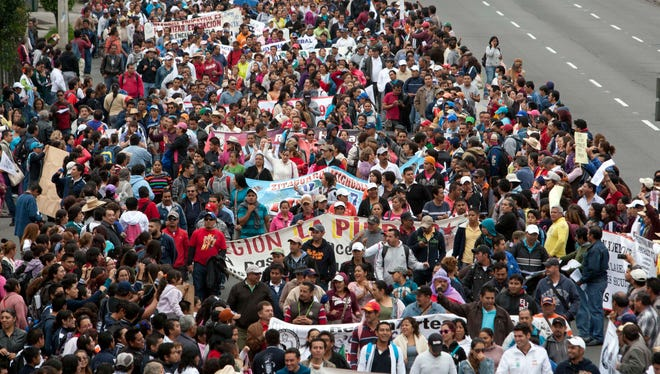Striking teachers march in a demonstration against the newly enacted education reform in Mexico City on Wednesday.
