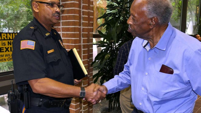 Newly confirmed Pensacola Police Chief David Alexander III is congratulated by local civil rights icon the Rev. H. K. Matthews. An installation ceremony and reception are scheduled for Wednesday, Aug. 5, to honor Pensacola's new Chief of Police.