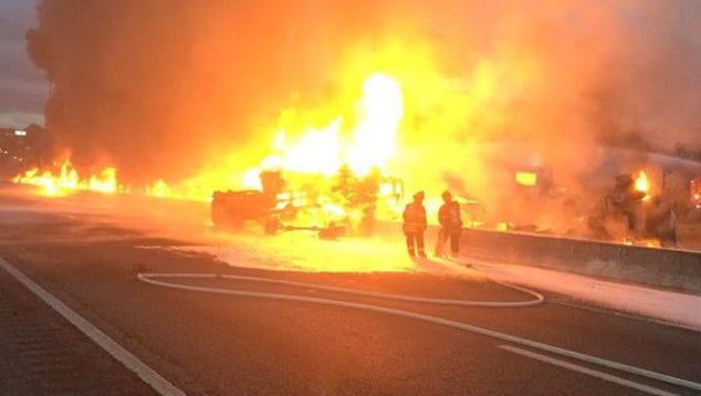 A fire engulfs vehicles along Interstate 26 northwest of Columbia, S.C., on Wednesday, May 27, 2015. More than 10 vehicles were involved in the early morning crash.