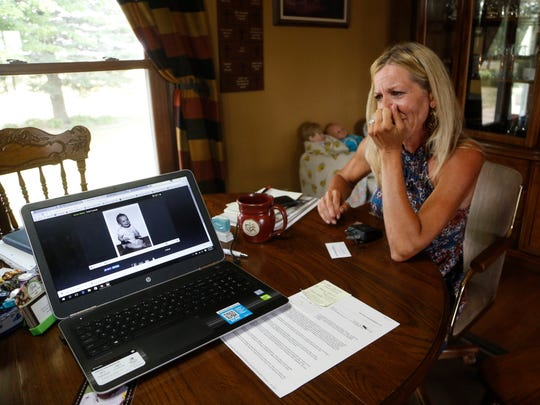Cyndi Mouw gets emotional as she looks at the video that was played at her husband's funeral Wednesday, July 19, 2017,  at her home in Orange City, Iowa. Mouw's husband, Todd Mouw, died after moving from in-home health care to an assisted living facility.