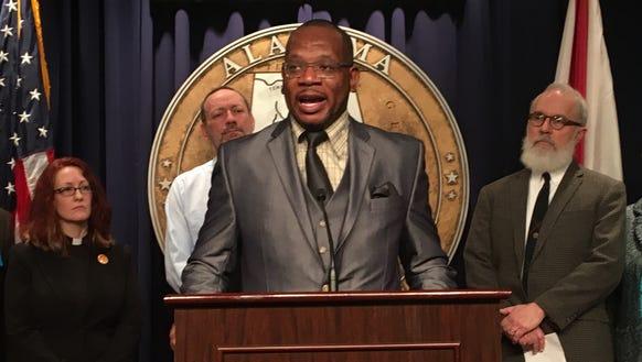 Rev. Marvin Charles Lue, Jr. speaks a press conference