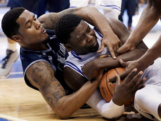 Seton Hall center Angel Delgado, right, has turned in a better offseason.